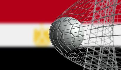 Soccer ball scores a goal in a net against Egypt flag. 3D Rendering