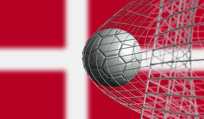 Soccer ball scores a goal in a net against Denmark flag. 3D Rendering