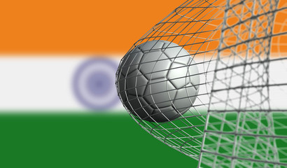 Soccer ball scores a goal in a net against India flag. 3D Rendering