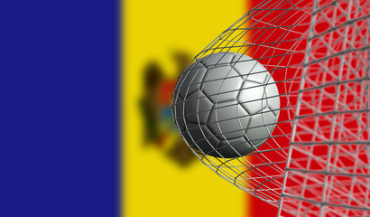 Soccer ball scores a goal in a net against Moldova flag. 3D Rendering