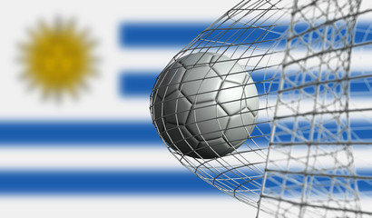 Soccer ball scores a goal in a net against Uruguay flag. 3D Rendering