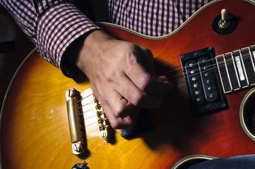 man plays the electric guitar