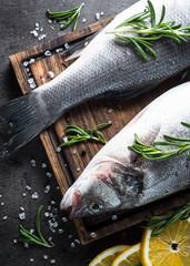 Fresh fish seabass on black.