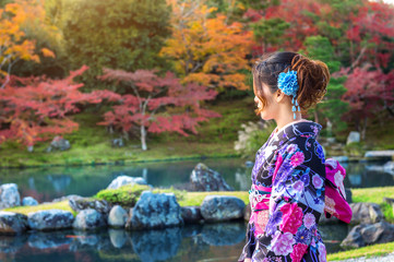 Wall Mural - Asian woman wearing japanese traditional kimono in autumn park. Japan