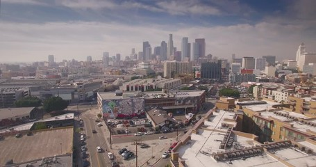 Fotobehang - Aerial view Arts district downtown Los Angeles skyline flyover 4K