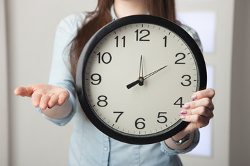 The girl with a clock