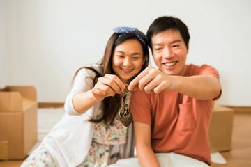 Happy couple holding key of new house