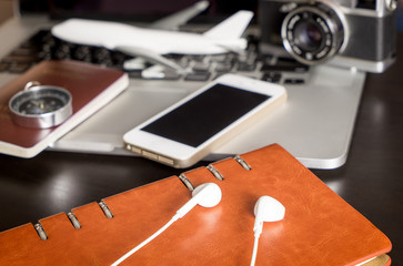 Modern Travel objects and accessories with computer and camera