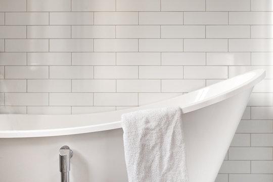 Towel on classic bathroom with white bathtub