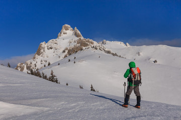 climbing on mountain in winter