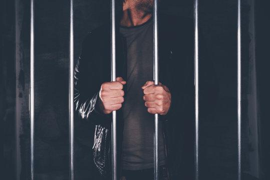 Man behind prison bars