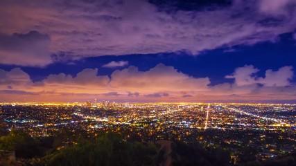 Fotobehang - Dramatic storm clouds city Los Angeles skyline night Zoom in 4K UHD Timelapse