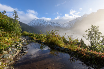misty morning view in wet mountain area in slovakian tatra. tourist hiking trail