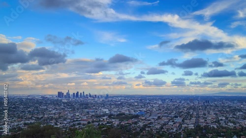 Fotobehang Storm clouds passing city of Los Angeles skyline changing from day to night Zoom