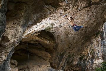 Rock climber in cave, Montanejos, Castellon, Valencia, Spain