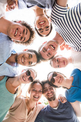 View from below. Group of young people looking the camera