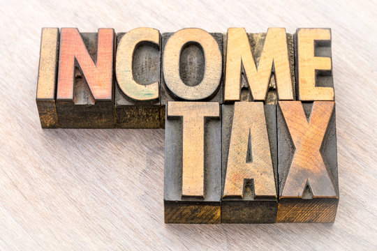 income tax word abstract in wood type