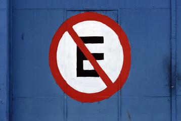 Plate forbidden parking stamped on blue garage door