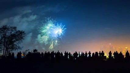 Fotobehang - Zoom in on crowd of people silhouettes watching colorful fireworks display show