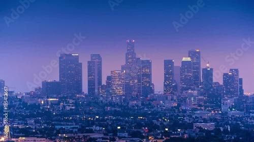 Fotobehang Low clouds moving over downtown Los Angeles skyline at dusk. 4K UHD timelapse.