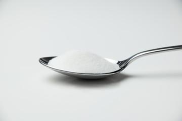 sugar in spoon full