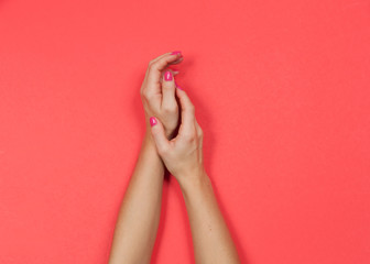Beautiful female hands with pink manicure