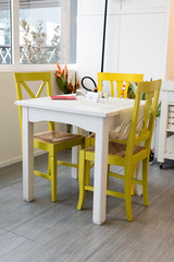 White table and chairs wooden yellow