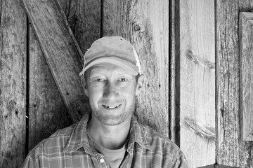 Average man head shot with a barn wood background.