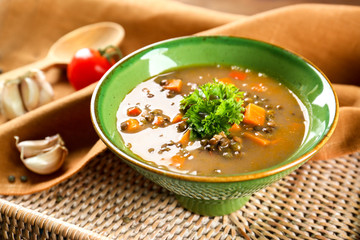 Dish with tasty lentil soup on tray