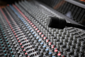 View of microphone over mixer in radio station