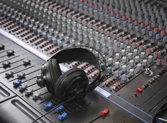Headphones on mixer in radio station