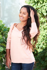 pretty latin indian girl outdoors smiling