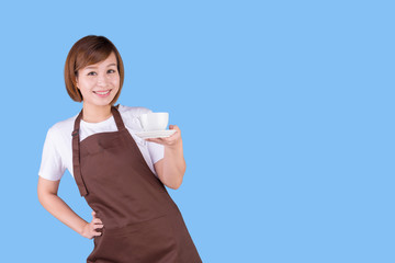 Coffee serving waitress. Young asian barista woman smiling showing cup of coffee. Isolated on solid color background.
