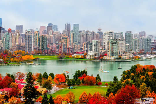 colorful autumn landscape of a modern city by the river