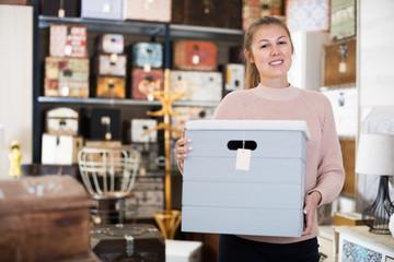 Woman choosing wooden box