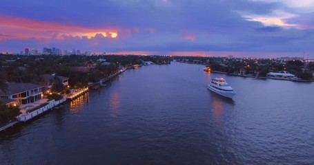 Fotobehang - Miami cityscape at sunset, yachts, boats commuting on river 4K UHD aerial view