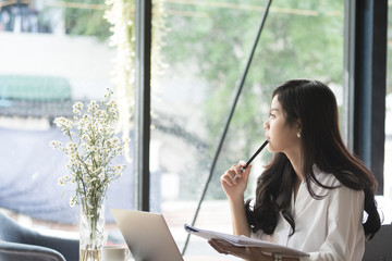 businesswoman analyze market chart at workplace. young female entrepreneur woman working with business document at office. analytic financial accounting plan report.