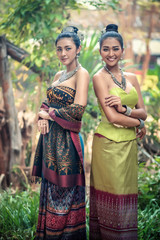 Two girl wears a local costume made of Thai silk.