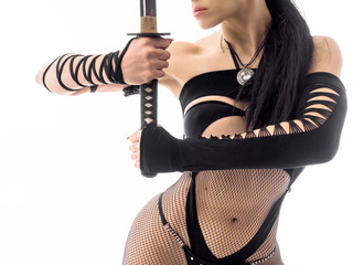 female perfect body with a samurai katana sword. Cosplay costume. Close up view.