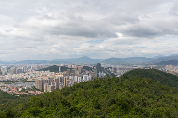 View on the modern city of Sanya and the hills of the tropical park from the observation deck in Lingchunling Forest Park in Hainan Island in China