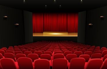 Theater stage with red curtains and seats