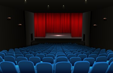 Theater stage with red curtains and blue seats