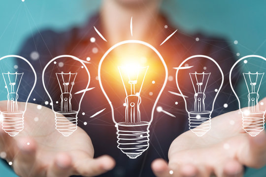 Businesswoman touching and holding a sketch lightbulb with a pen