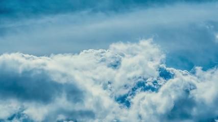 Fotobehang - Epic storm clouds over blue sky background. 4K UHD Timelapse.
