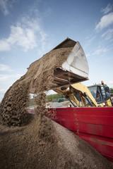 Fototapete - Excavator moving sand and gravel