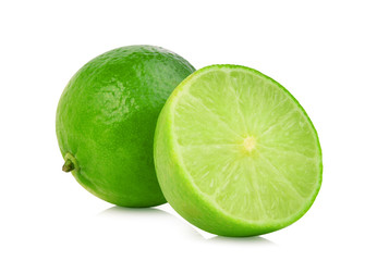 whole and half fresh green lime isolated on white background