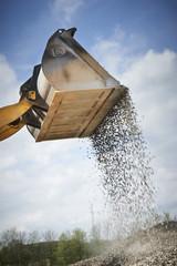 Fototapete - Excavator moving sand