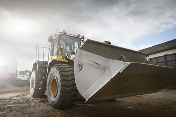 Wall Mural - Excavator moving sand