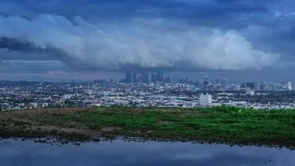 Klistermärke - Los Angeles cityscape skyline with storm clouds at dusk 4K UHD timelapse