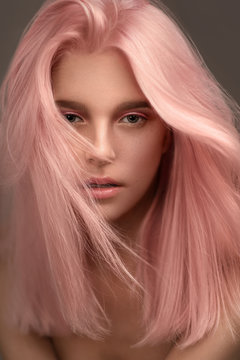 Portrait of beautiful woman with pink hair looking at camera